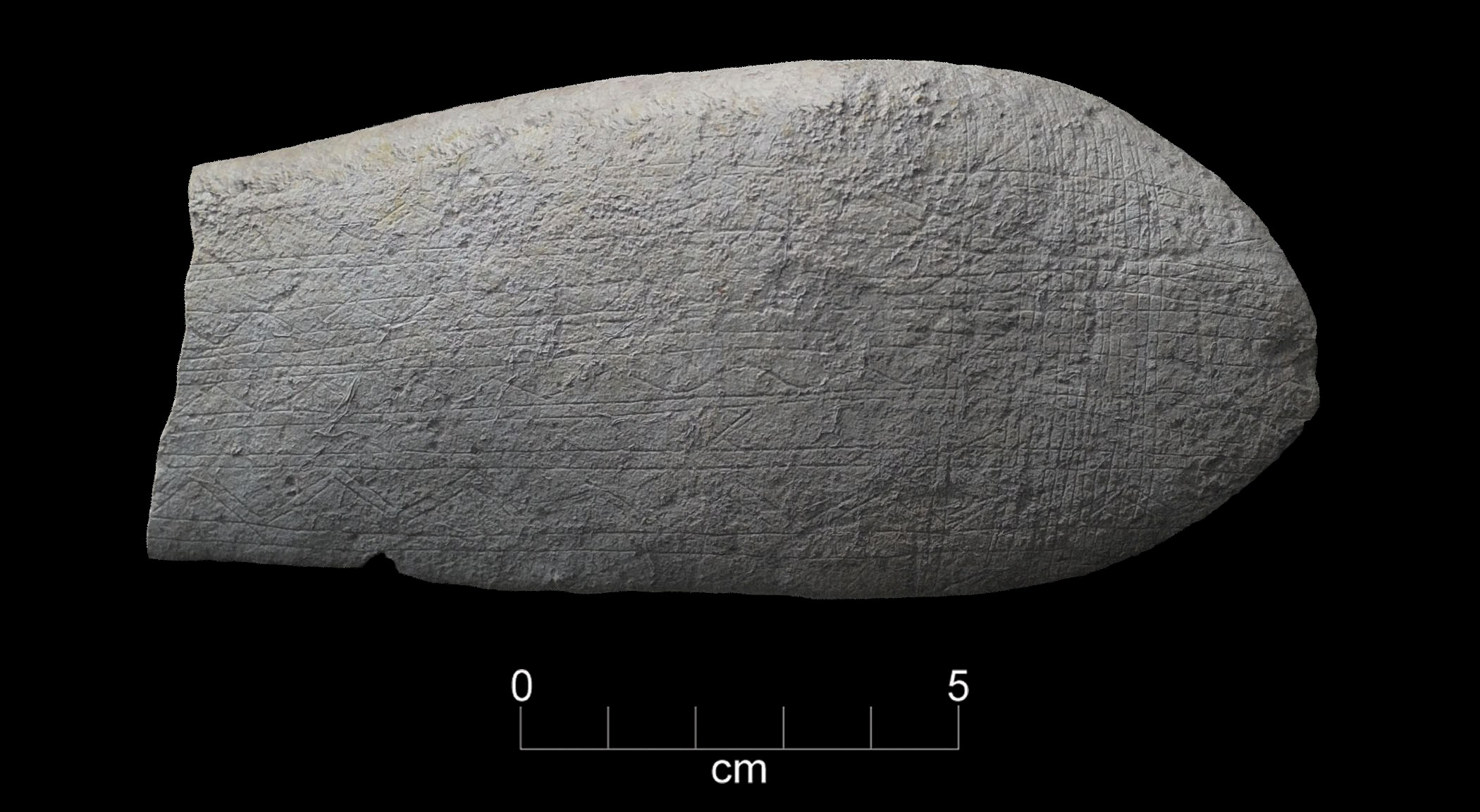 Geometric engravings on a stone found at the Gault site