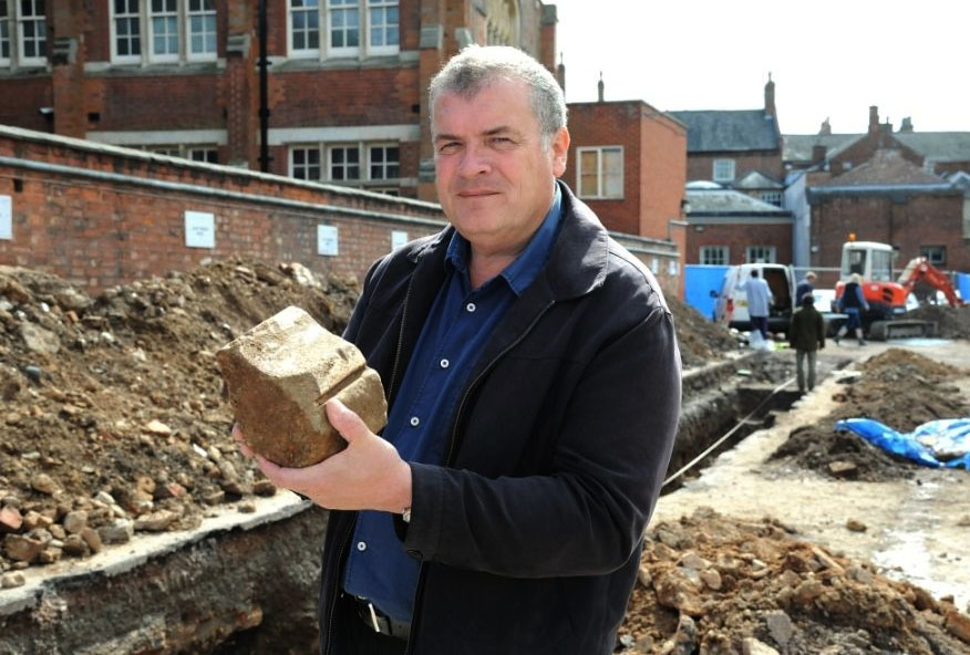 Lead archaeologist Richard Buckley with a piece of tracery that once held a window