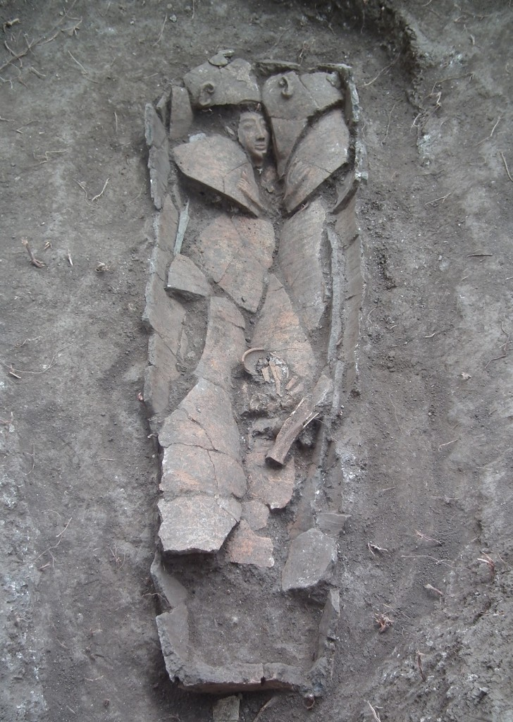 The clay coffin at the time of its discovery in the field. Photograph: Dan Kirzner, courtesy of the Israel Antiquities Authority.